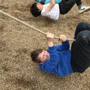 children climbing a rope